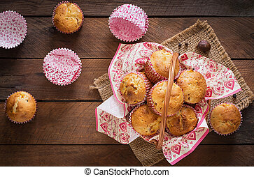 Fruit muffins with nutmeg and allspice in a wicker basket on...