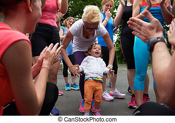 jogging people group have fun with baby girl