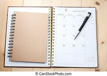 blank desktop calendar with text book