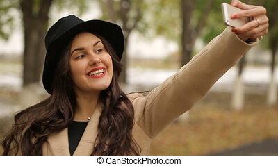 Beautiful girl posing for a selfie
