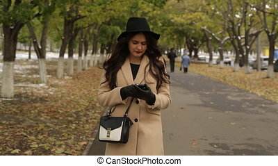 Girl walking and read message