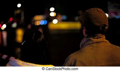 Young Couple Watching Car Drifting At Night - Backs of...