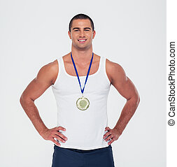 Portrait of a smiling sports man standing with medal