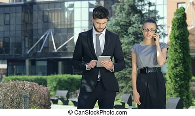 Couple standing together, work on the tablet, gets good performance