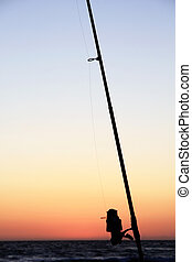Fishing pole silhouette - View of a fishing pole silhouette...