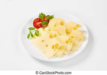 slices of Swiss cheese - thin slices of emmental cheese on...