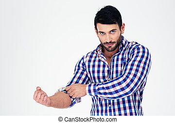 Portrait of a handsome man rolls up his sleeves