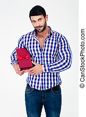 Portrait of a handsome man holding gift box isolated on a...
