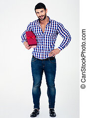 Full length portrait of a happy man holding gift box...
