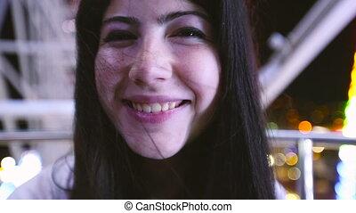 Beautiful young woman smiling at camera - Beautiful brunette...
