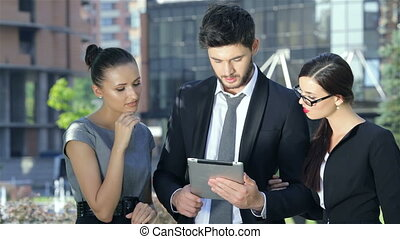 Close up of business partners are working on a tablet, get good news and rejoice