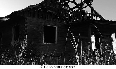 Scary old burnt haunted house. Black and white video Wide...
