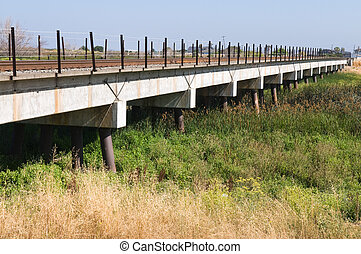 Trestle - Railroad trestle over grasslands, Alviso,...