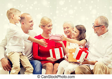 smiling family with gifts at home