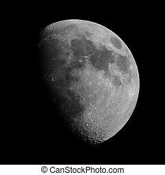 Black and white Gibbous moon - Gibbous moon over dark black...