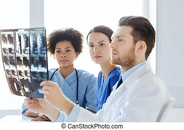 group of doctors looking to x-ray at hospital - radiology,...