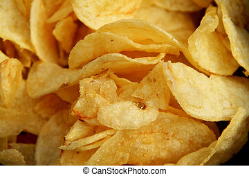 chips or crisps cloe up backdrop - background of potato...