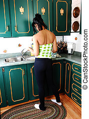 Young woman in kitchen.