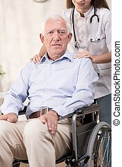 Man and wheelchair - Old and ill man needs a wheelchair