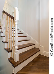 Wooden stairs with railing - Close up of beautiful solid...