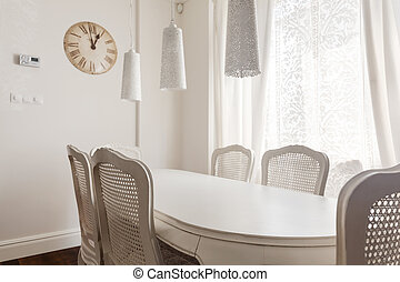White table and chairs - Image of white table and chairs in...
