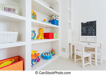 White furnitures in child room - Zoom of white wooden...