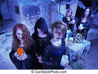 Coven of Five Witches - Coven of five witches outdoors...