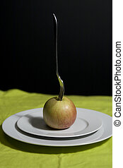 low calorie meal - apple on a white plate with fork in it...