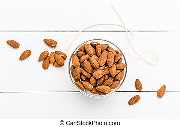 Almonds on a white background - Several almonds on a white...