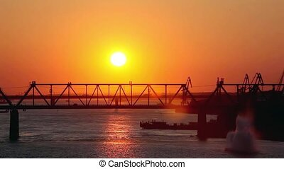 beautiful bridges at amazing sunset with a passing train,...