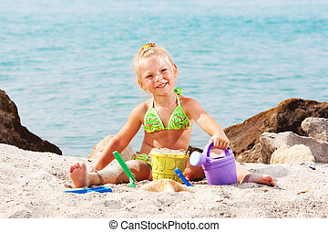 Little Girl Playing On The Beach - Heppy Little girl playing...