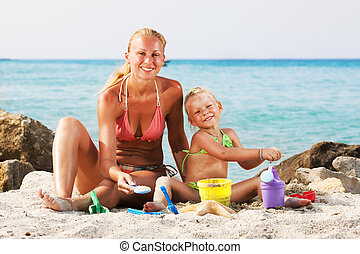 Little Girl With Mother On The Beach