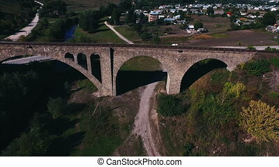 aerial shot of the stone railway bridge outside the city
