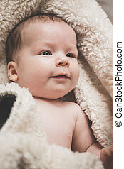 Baby swaddle with towel - Image of content smiling baby...