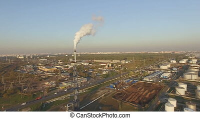 View of large oil refinery with gas burning facility
