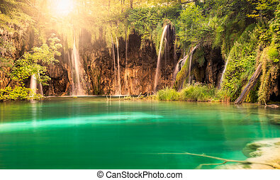Waterfall with sun at Plitvice Lakes National Park, Croatia
