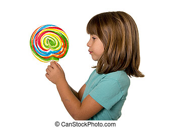 child with lollipop - 4 or 5 years old child girl eating big...
