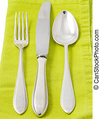 Silverware on green napkin