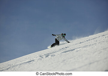 snowboard woman racing downhill slope and freeride on powder...