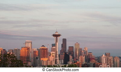 Time lapse zoom out Seattle skyline at sunset with golden...