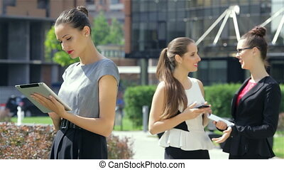 Business woman reads the news on the background of their business partners