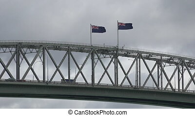Auckland harbor bridge New Zealand from a boat point of view