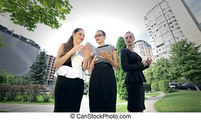 Successful business partners are working on a tablet, get...