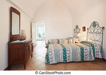 Old bedroom with two beds