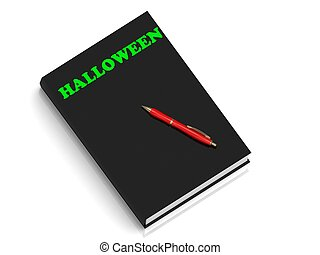 HALLOWEEN- inscription of green letters on black book on...
