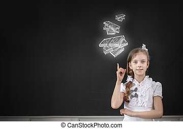 Girl at blackboard - Cute school girl pointing at money...