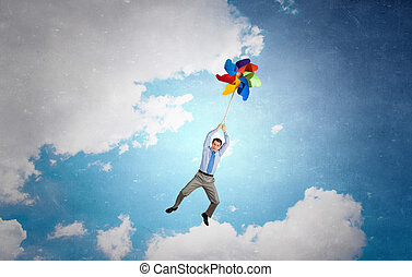 Great day for freedom - Young happy businessman flying in...