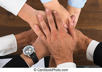 Businesspeople Hands Stacking Over Each Other - High Angle...