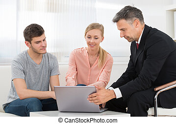 Consultant Explaining Investment Plan To Couple - Financial...