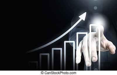 Media interface - Businessman hand pushing business graph on...